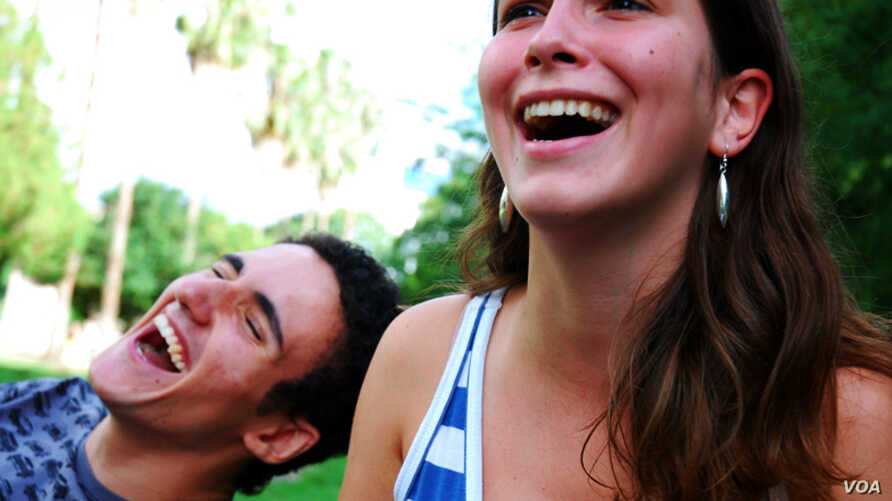 Two people laughing.