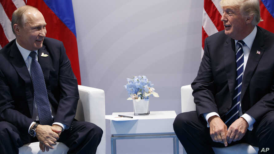 FILE - President Donald Trump meets with Russian President Vladimir Putin at the G20 Summit.