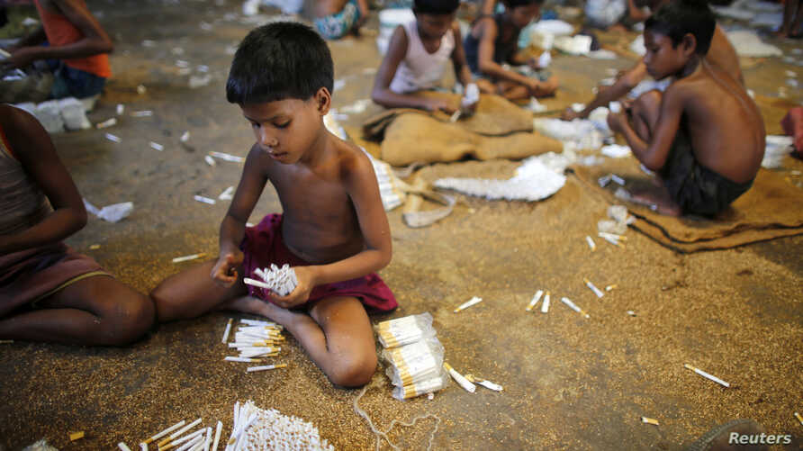 Children fill up empty cigarettes manually with locally grown tobacco in a small factory at Haragach in Rangpur district, Bangladesh, in this July 11, 2013, file photo.
