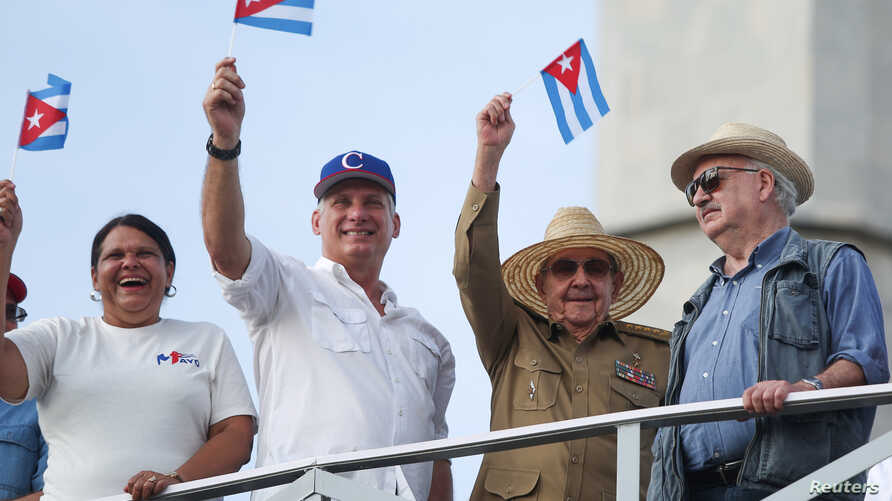 Cuba's First Secretary of the Communist Party and former President Raul Castro, 2nd right, Cuba's President Miguel Diaz-Canel, 2nd left, First Secretary of the Communist Party in Havana Lazara Mercedes Lopez, left, and president of the Communist Part