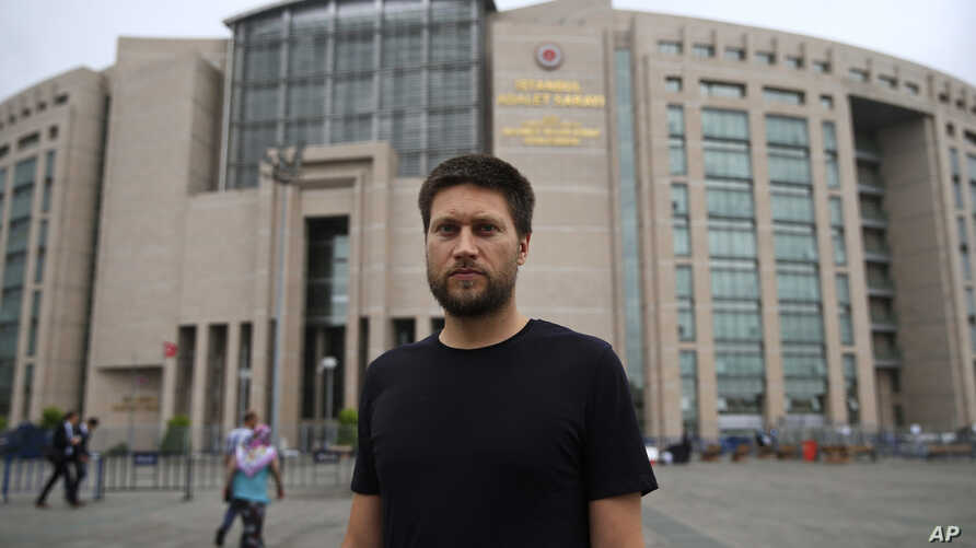 Andrew Gardner, researcher for Turkey of Amnesty International, poses outside Istanbul's court, July 17, 2017.  Ten Turkish human rights activists, including Amnesty International's Turkey director Idil Eser, were detained by police and were to appea