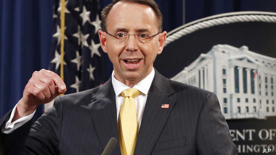 Deputy Attorney General Rod Rosenstein announces that a grand jury has charged 13 Russian nationals and several Russian entities, Feb. 16, 2018, in Washington. The defendants are accused of violating U.S. criminal laws to interfere with American elec