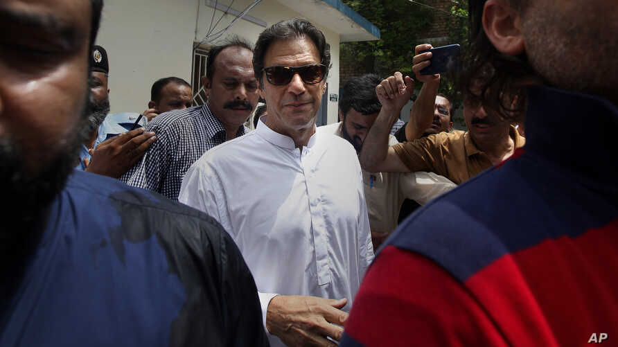 Pakistani politician Imran Khan, chief of Pakistan Tehreek-e-Insaf party, arrives to cast his vote at a polling station for the parliamentary elections in Islamabad, Pakistan,  July 25, 2018.