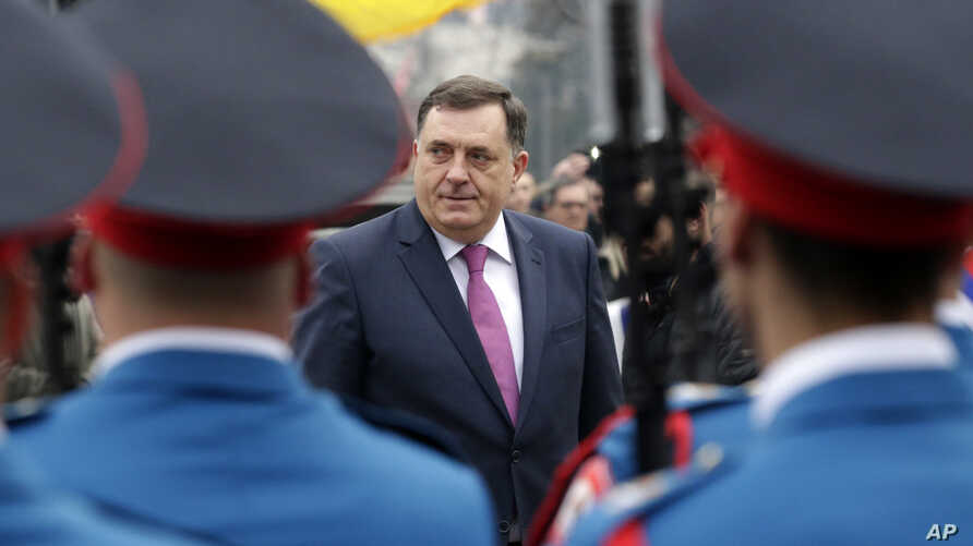 FILE - President of the Bosnian Serb Republic Milorad Dodik inspects an honor guard during a parade in the Bosnian town of Banja Luka, Jan. 9, 2018.
