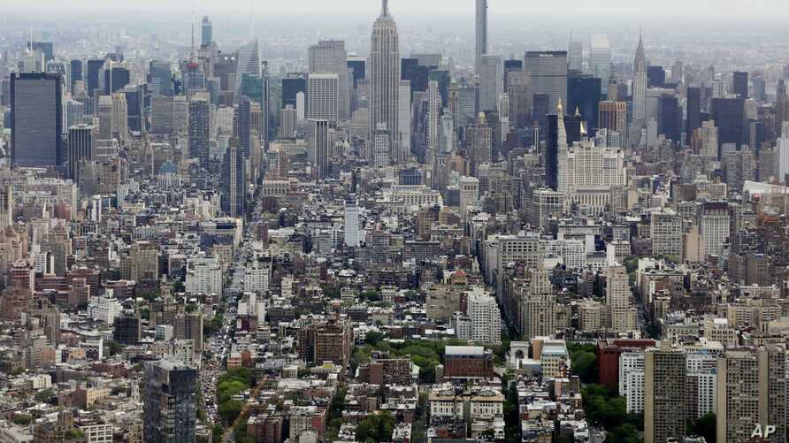 FILE- In this May 20, 2015 file photo, Midtown Manhattan, including the Empire State Building, center, are seen from the observatory at One World Trade Center in New York.