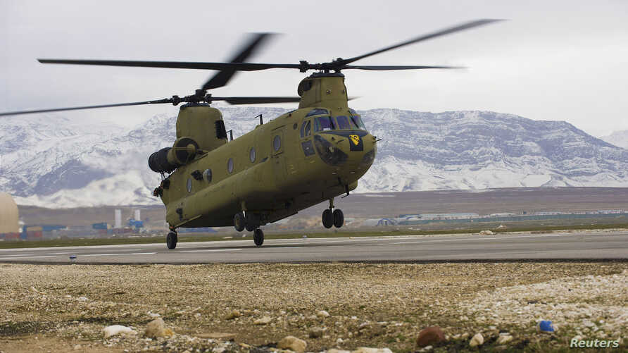 A U.S. CH-47F Chinook helicopter lands on the flight line after a maintenance test flight at Camp Marmal, in Mazar-e Sharif province, Afghanistan in this February 9, 2012 photo by the U.S. Army.