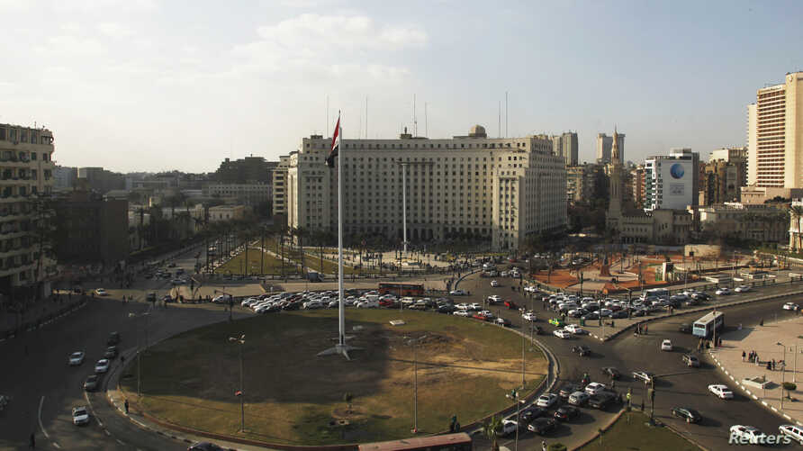Egypt's national flag is seen raised at the top of a flag pole, which was recently installed in Tahrir square, in central Cairo, Feb. 8, 2015.