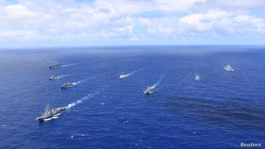 Ships of the U.S., Chilean, Peruvian, French and Canadian navies participate in a photo exercise in the Pacific Ocean, Jun. 24, 2018. (U.S. Navy)