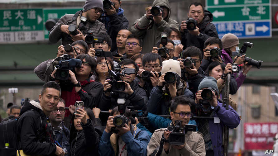 FILE - Journalists follow Tsai Ing-wen, then a presidential candidate, as she campaigns in Taipei, Jan. 13, 2016.