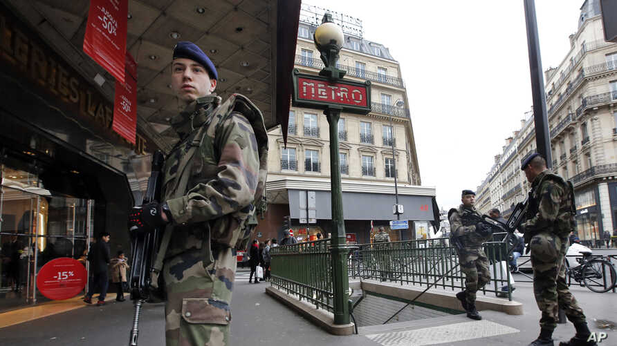 "French soldiers patrol in the street near a department store in Paris as part of the highest level of ""Vigipirate"" security plan in Paris January 10, 2015."