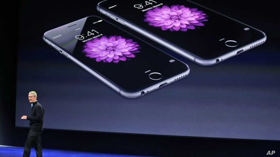 FILE - In this March 9, 2015, file photo, Apple CEO Tim Cook talks about the iPhone 6 and iPhone 6 Plus during an Apple event in San Francisco. Apple is apologizing for secretly slowing down older iPhones, which it says was necessary to avoid unexpec