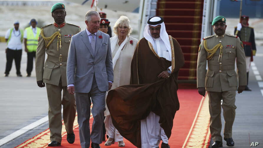 Britain's Prince Charles speaks to Bahrain's Crown Prince Salman bin Hamad bin Isa Al Khalifa upon arriving in Manama, Bahrain, Nov. 8, 2016. Prince Charles and his wife Camilla, seen behind the two princes, are on a three-nation tour of the Gulf.