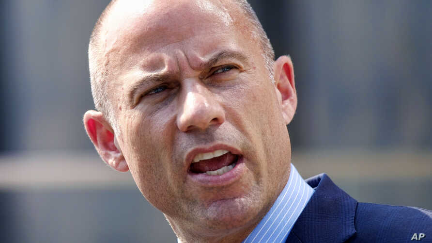 FILE - Michael Avenatti, the attorney for porn actress Stormy Daniels, talks to the media during a news conference in front of the U.S. Federal Courthouse in Los Angeles, July 27, 2018.