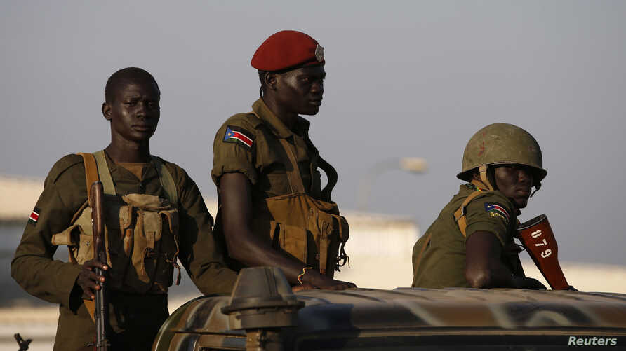 South Sudan army soldiers are seen standing in a vehicle in Juba Dec. 20, 2013.