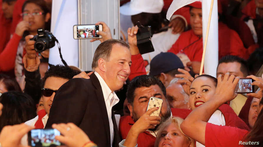 FILE - Jose Antonio Meade, former Mexico Finance Minister, poses for selfies with his supporters after registering as a presidential pre-candidate for the Institutional Revolutionary Party (PRI), in Mexico City, Mexico, Dec. 3, 2017.