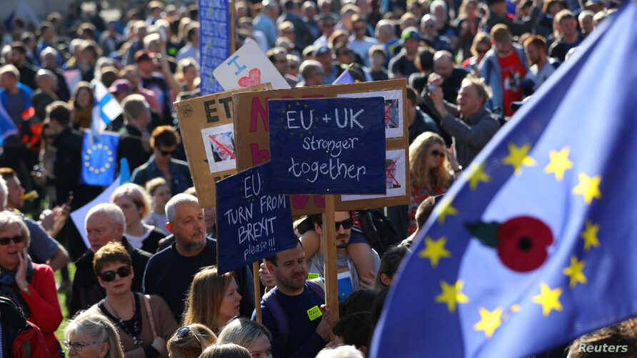 Protesters, participating in an anti-Brexit demonstration, march through central London, Britain, Oct. 20, 2018.