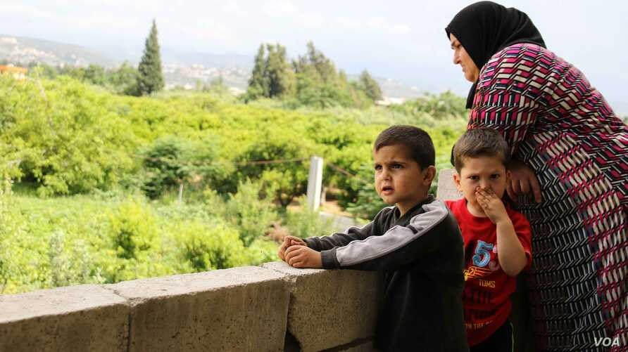 Mother-of-four Sobhiyeh and some of her family. (J. Owens for VOA)