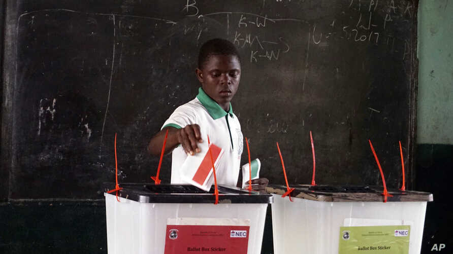 A man cast his vote during the first round of presidential elections in Monrovia, Liberia, Oct. 10, 2017.