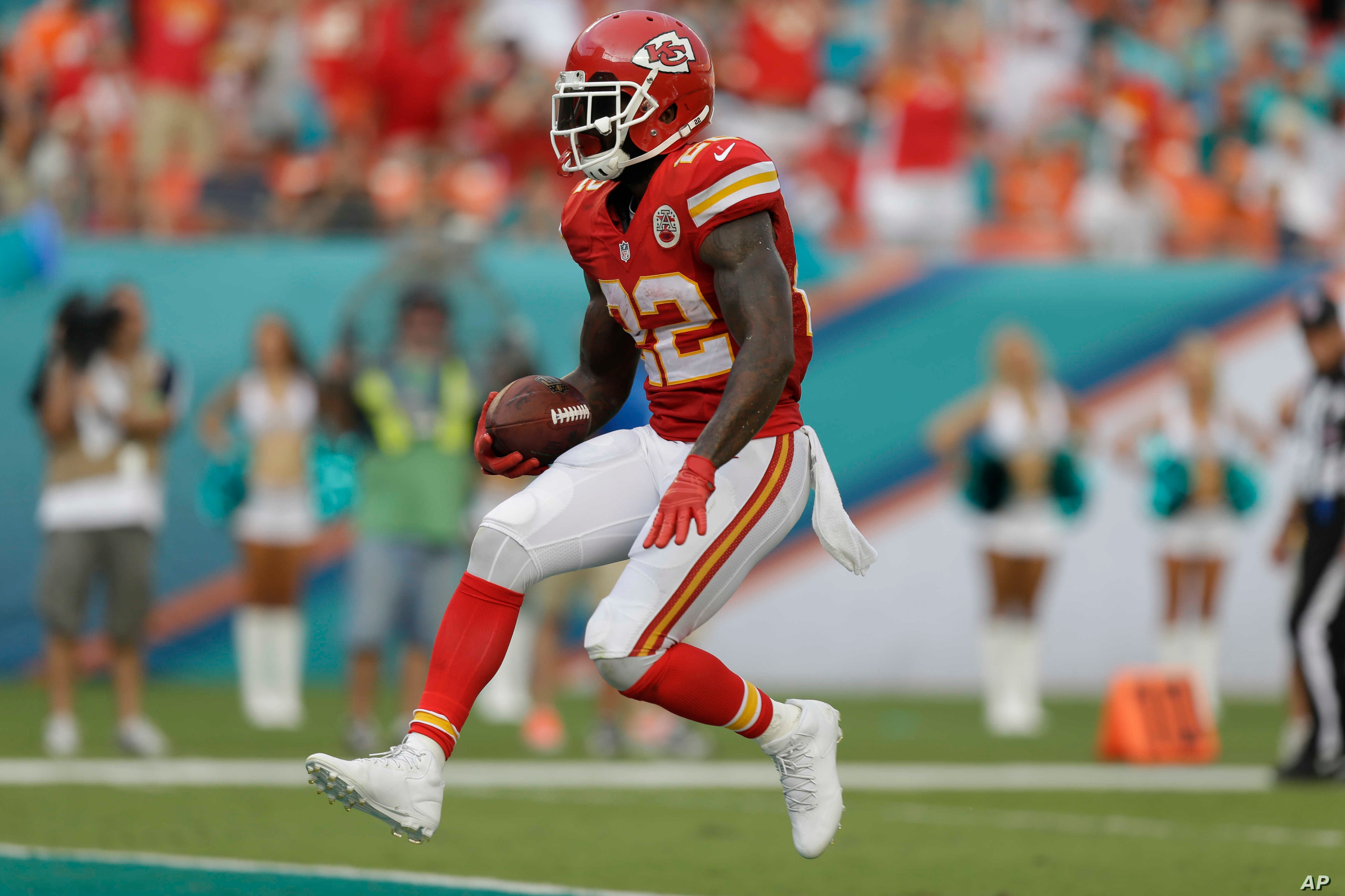 FILE - Then-Kansas City Chiefs running back Joe McKnight (22) scores a touchdown during the second half of an NFL football game against the Miami Dolphins.