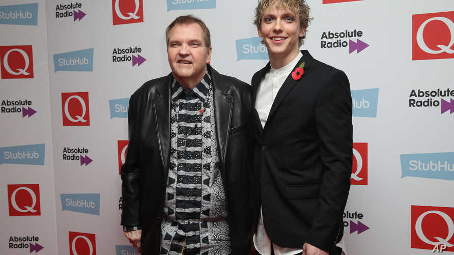 FILE - Meat Loaf and Andrew Polec pose for photographers upon arrival for the Q Music Awards, at the Camden Roundhouse in London, Nov. 2, 2016.