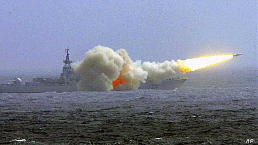 A destroyer of the South China Sea Fleet of the Chinese Navy fire a missile during a training in South China Sea (File)