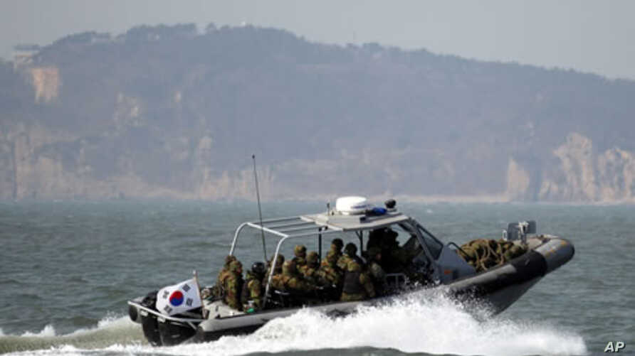 South Korean navy sailors in a speed boat patrol around South Korea's western Yeonpyong Island after finishing their exercise, near the disputed sea border with North Korea, February 20, 2012.
