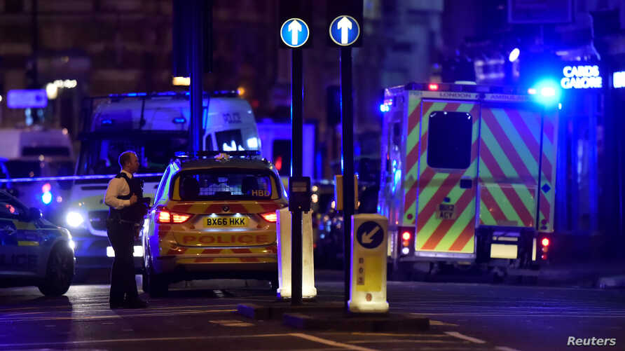 Police attend to an incident on the London Bridge in London, June 3, 2017.