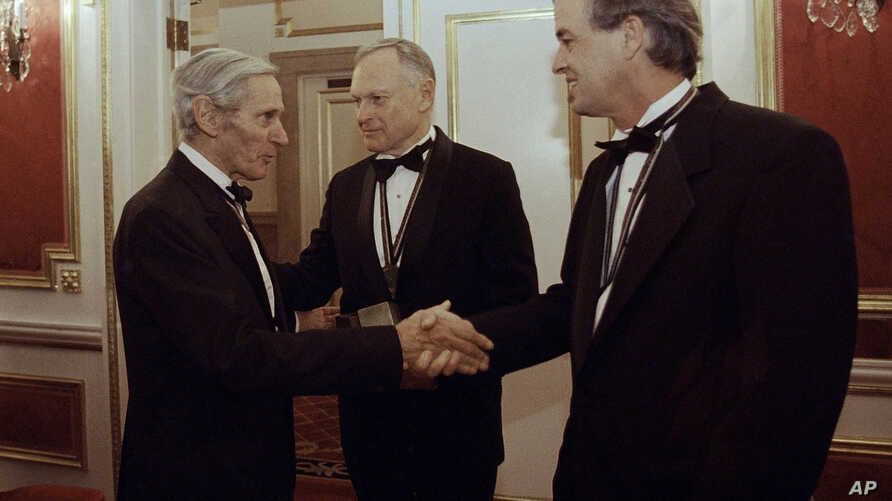 FILE - In this Nov. 16, 1994, photo, The National Book Awards prize winning writers, William Gaddis (L), Sherwin B. Nuland (C), and James Tate greet each other after the awards ceremony in New York.