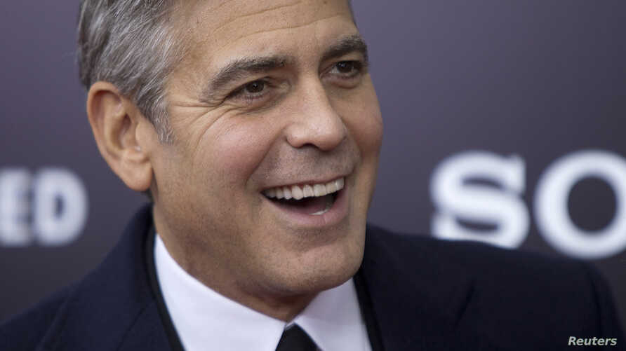 """Cast member George Clooney arrives for the premiere of his movie """"The Monuments Men"""" in New York, Feb. 4, 2014."""