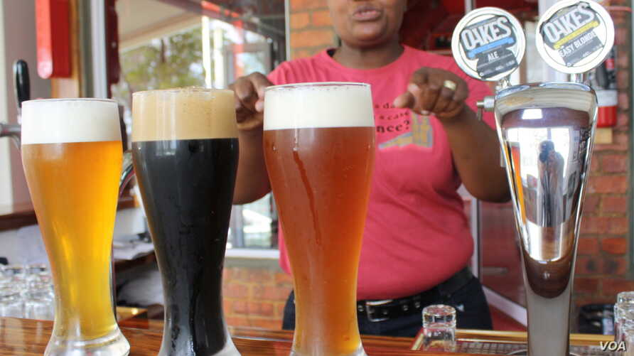 Brewer Happy Sekanka with some of her unique craft beers inside Oakes Brew House in Johannesburg. (Darren Taylor)