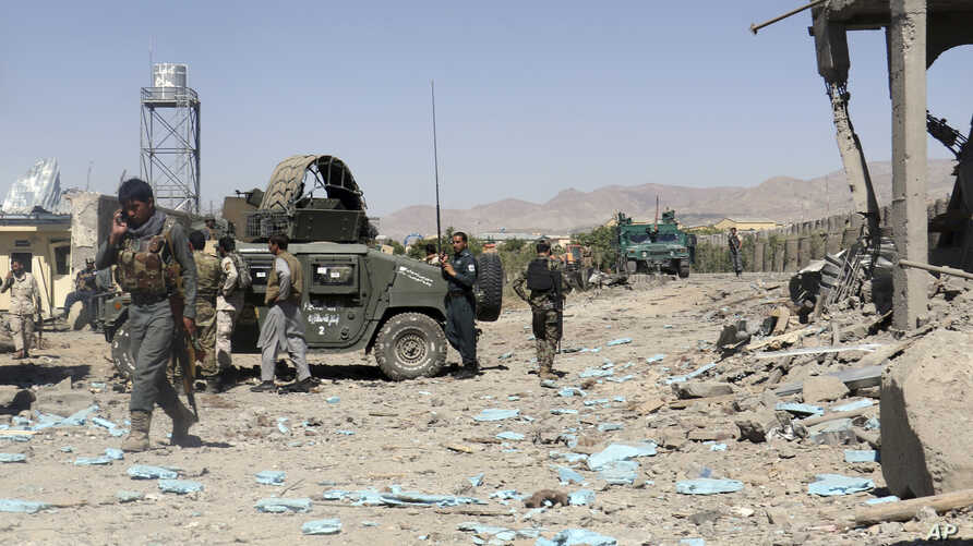 Security forces are deployed at the site of suicide attacks and an ongoing clash between Taliban insurgents and government forces in the main police station in eastern Paktia province, Afghanistan, Jun 18, 2017. The Taliban stormed a police headquart