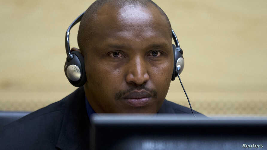 Congolese warlord Bosco Ntaganda looks on during his first appearance before judges at the International Criminal Court in the Hague, March 26, 2013.
