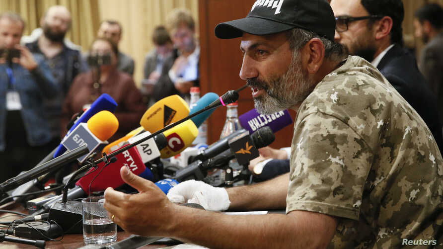 Armenian opposition leader Nikol Pashinyan speaks during a news conference in Yerevan, Armenia, April 24, 2018.