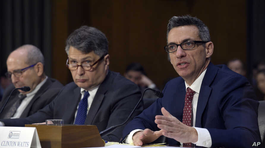 Clint Watts, right, a Senior Fellow at the Foreign Policy Research Institute Program on National Security, testifies before the Senate Intelligence Committee hearing on Capitol Hill in Washington, March 30, 2017, on Russian intelligence activities.