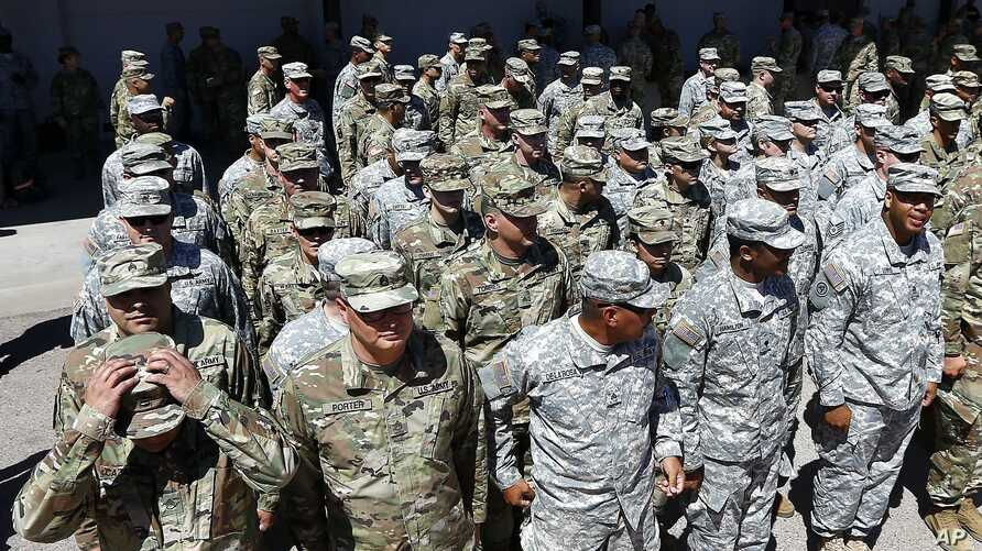 Arizona National Guard soldiers line up as they get ready for a visit from Arizona Gov. Doug Ducey prior their deployment to the Mexico border at the Papago Park Military Reservation, April 9, 2018, in Phoenix.