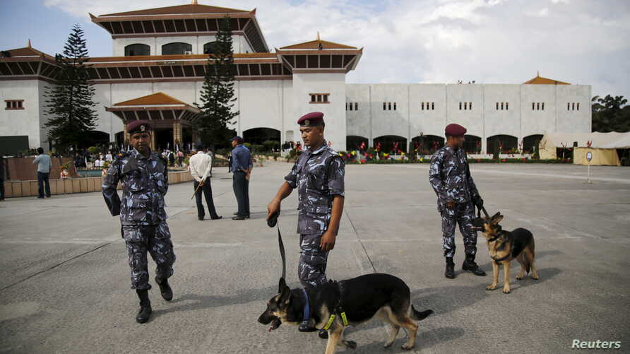 FILE - Nepalese police with sniffer dogs secure the premises of the parliament before President Ram Baran Yadav formally promulgates the new constitution in Kathmandu, Sept. 2015.