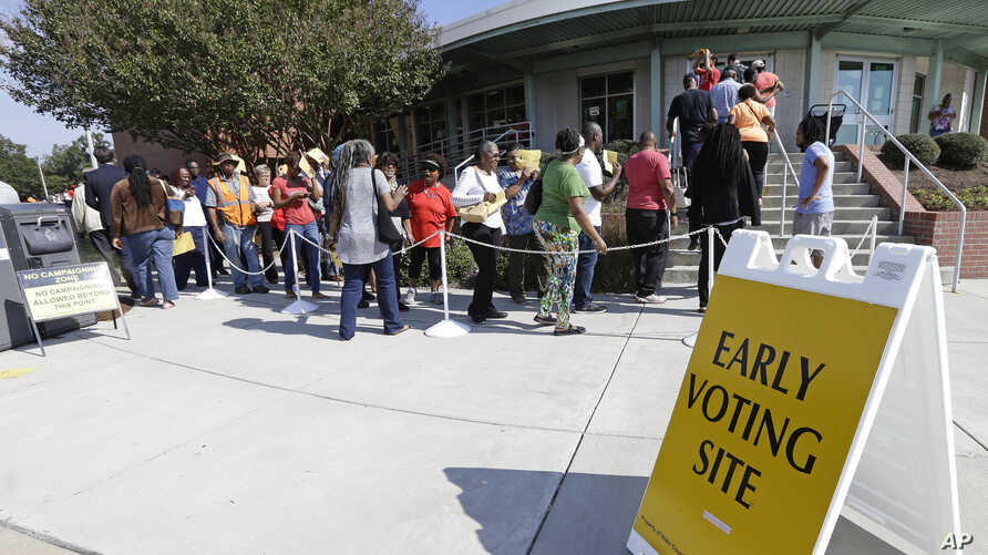 Voters line up during early voting in Raleigh, North Carolina, Oct. 20, 2016.