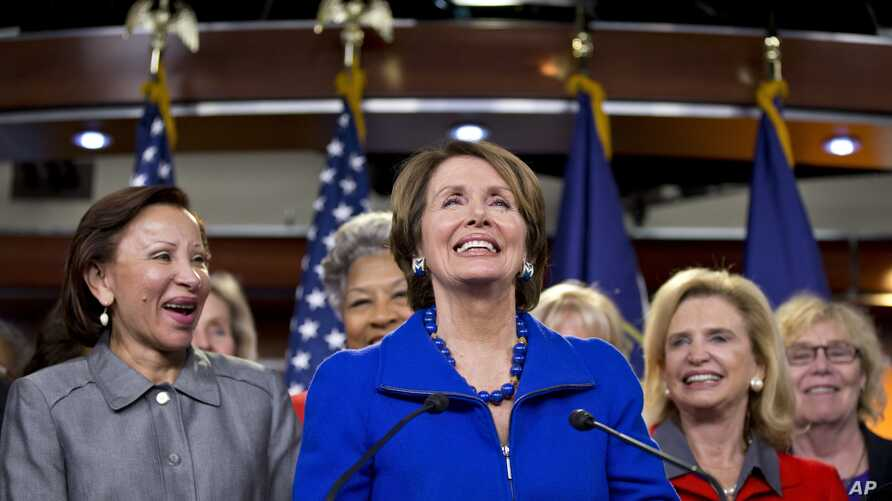House Minority Leader Nancy Pelosi Calif., accompanied by women House Democrats, announces during a news conference on Capitol Hill, Nov. 14, 2012, that she wants to remain as the top Democrat in the House of Representatives.