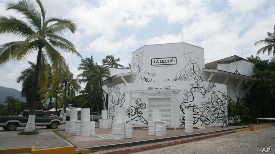 """The entrance of the restaurant """"La Leche"""" stands closed after armed men abducted as many as 16 people who were dining in the upscale restaurant in Puerto Vallarta, Mexico, Aug. 15, 2016."""