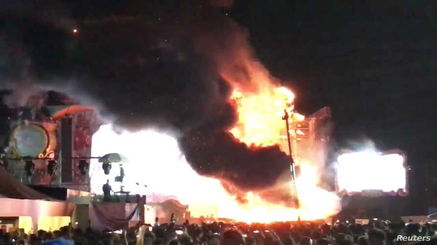 Smoke rises from flames engulfing the stage after a fire broke out at Tomorrowland Unite Spain festival in Barcelona, Spain, July 29, 2017, in this still image from a video obtained from social media. (Alex Prim Lopez via Reuters)