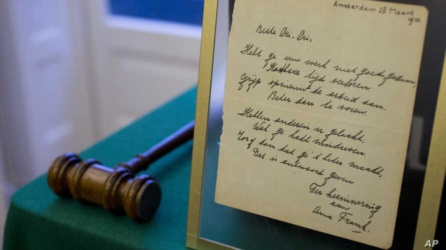 A short poem by Anne Frank, handwritten and dated in Amsterdam on March 28, 1942, is displayed at Bubb Kuyper auction house prior to the auction in Haarlem, Netherlands, Wednesday, Nov. 23, 2016.