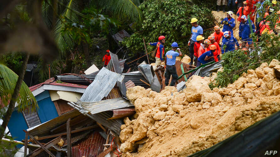 Rescuers search for survivors at the landslide site in Naga City, on the popular tourist island of Cebu, Sept. 20, 2018. At least three people were killed and 10 homes buried early Thursday in the central Philippines when heavy monsoon rains unleashe...