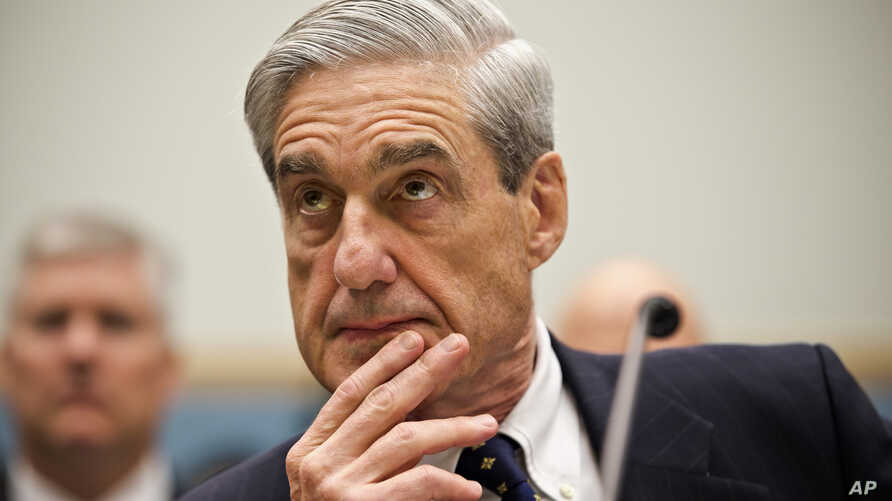FBI Director Robert Mueller listens as he testifies on Capitol Hill in Washington, June 13, 2013.