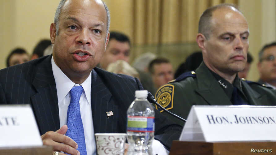 FILE - From left, U.S. Homeland Security Secretary Jeh Johnson and U.S. Customs and Border Protection Deputy Chief Ronald Vitiello testify at a House Homeland Security Committee hearing on Capitol Hill in Washington, June 24, 2014.