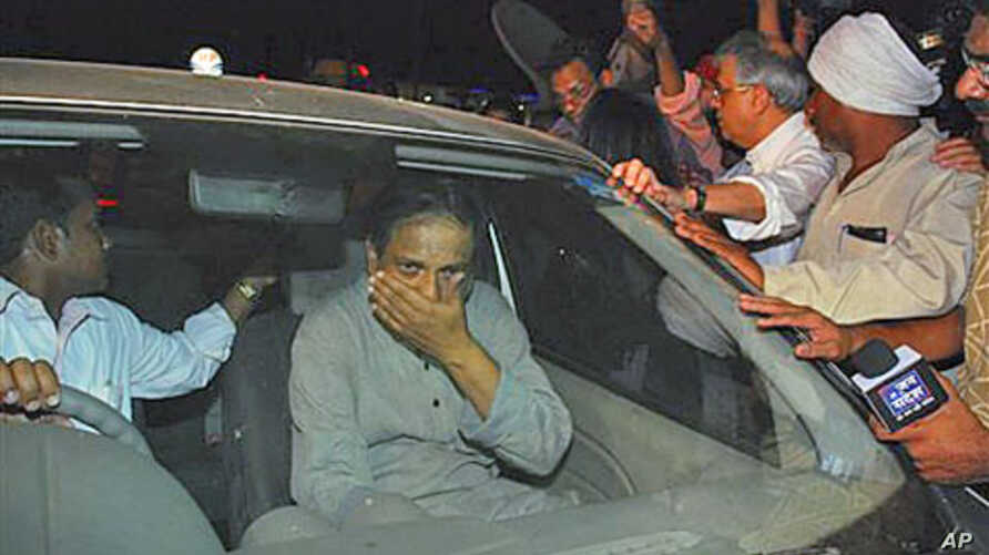 Jailed Indian doctor and human rights activist Binayak Sen, center, is mobbed by his family and supporters as he sits in a car after his release from the prison in Raipur, Chattisgarh state, India, April 18, 2011