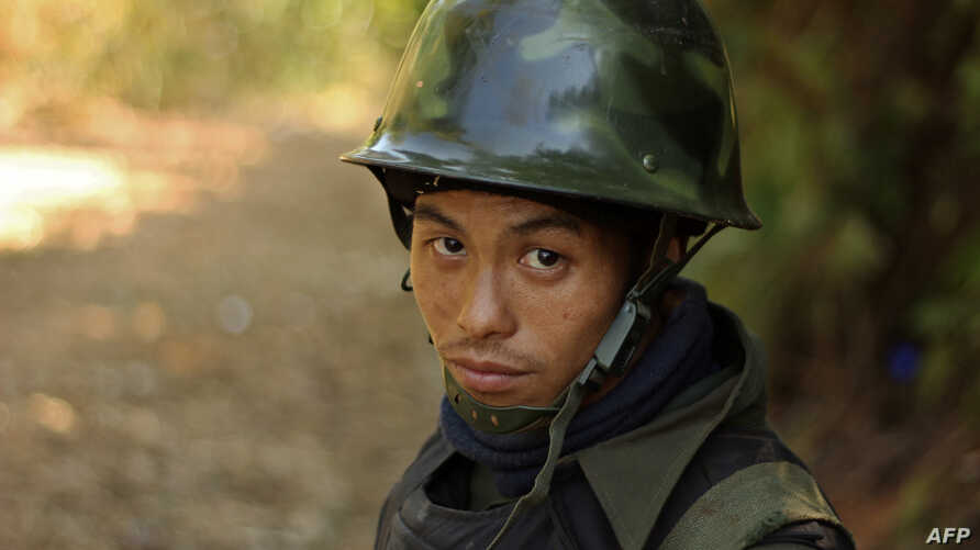 A rebel Kachin Independence Army (KIA) 3rd Brigade soldier stands guard as they secure an area on Hka Ya mountain in Kachin province on January 20, 2013.