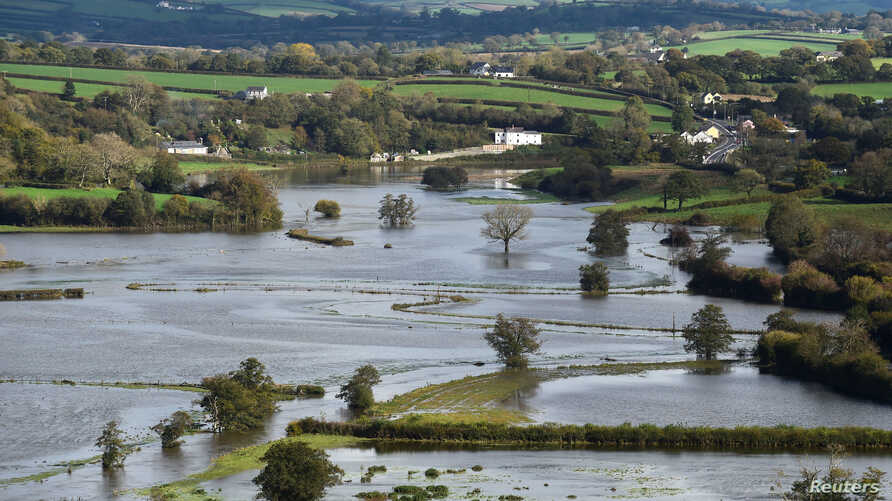 FILE - Fields are covered in floodwater after Storm Callum passed through the town of Carmarthen, west Wales, Britain, Oct. 14, 2018.