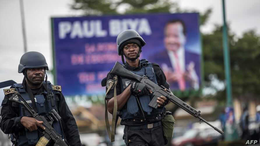 Members of the Cameroonian Gendarmerie patrol in the Omar Bongo Square of Cameroon's mostly anglophone South West province capital Buea, Oct. 3, 2018, during a campaign rally of the ruling CPDM party of incumbent Cameroonian President Paul Biya.