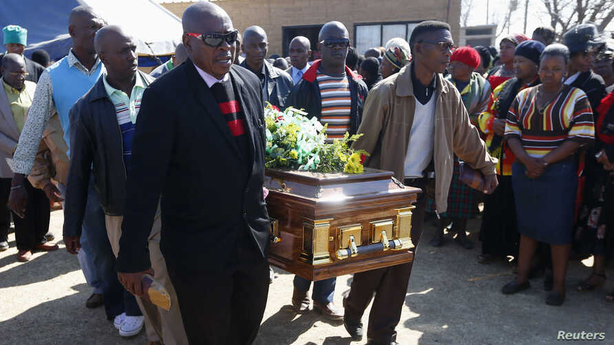 Mourners carry the casket of Andries Motlapula Ntsenyeho, one of the 34 striking platinum mineworkers shot dead at Lonmin's Marikana mine, at his home town of Sasolburg in South Africa's Free State province, September 1, 2012.
