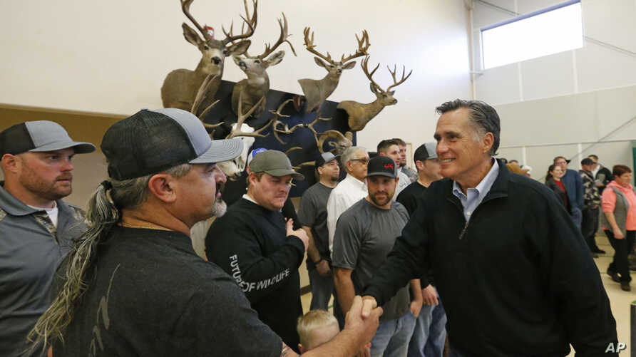 Mitt Romney shaking hands during a campaign stop at the Sportsmen for Fish and Wildlife Banquet, in Blanding, Utah, March 2, 2018.